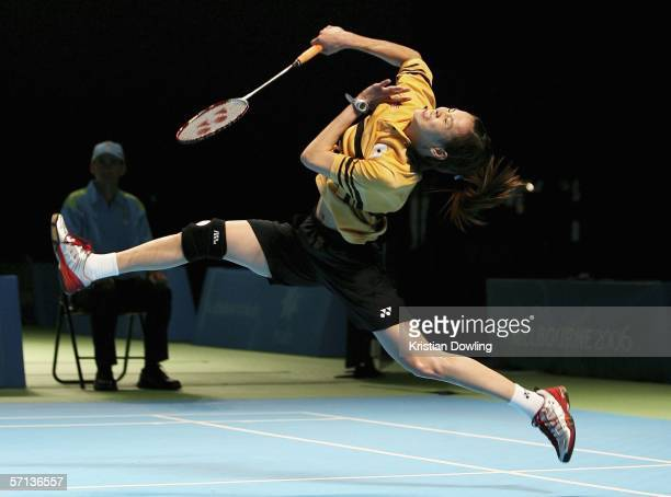 Mew Wong of Malaysia plays an overhead smash during the gold medal mixed team badminton match against Jayne Tracey Hallam of England on day five of...