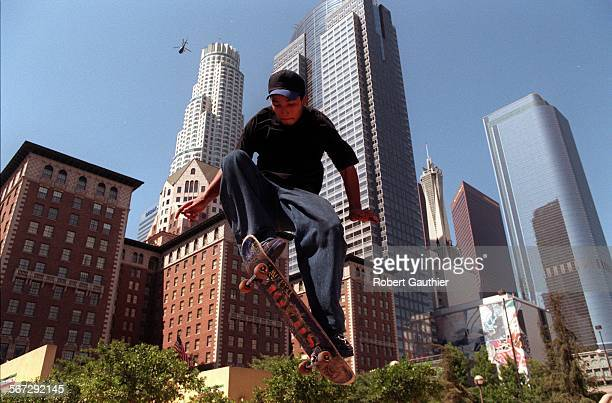 MEweather10823RG –– Joseph Geraldo of South Los Angeles gets airborne while skateboarding through Pershing Square in downtown Los Angeles Sunday...