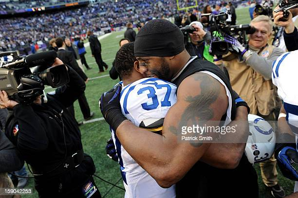 Mewelde Moore of the Indianapolis Colts congratulates Ray Lewis of the Baltimore Ravens after the Ravens won 249 during the AFC Wild Card Playoff...