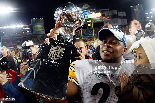 Mewelde Moore of the Pittsburgh Steelers holds up the Vince Lombardi trophy as he celebrates with his daughter Jalyn Chantelle after their 27-23 win...