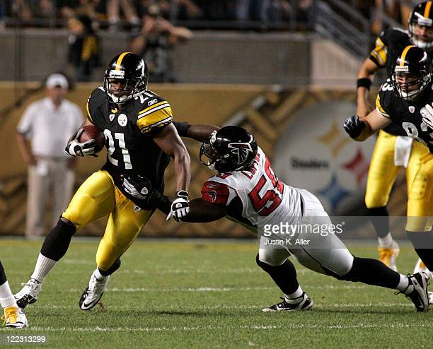 Mewelde Moore of the Pittsburgh Steelers runs the ball against Curtis Lofton of the Atlanta Falcons during a preseason game on August 27 2011 at...