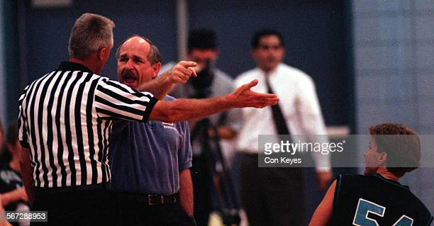 MEWheel/Coach0327CK/F Timberwovles Coach Perry Hendricks gives a piece of his mind to Russ Johnson about his poor officiating WomenÕs national...