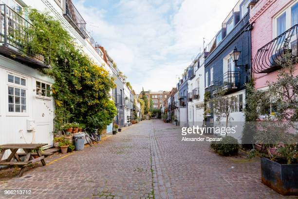 mews houses along cobbled street in notting hill, london, england, uk - street stock pictures, royalty-free photos & images