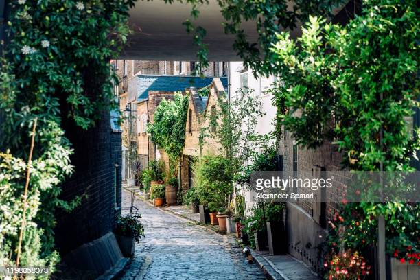 mews houses in fitzrovia district, london, england, uk - village stock pictures, royalty-free photos & images