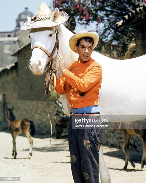 Mexican actor and comedian Cantinflas with a white horse wearing a straw hat in 'Pepe' directed by George Sidney 1960 Cantinflas plays the title role...