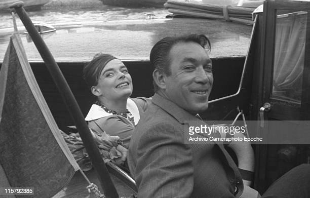 Mexican actor Anthony Quinn wearing a plaid blazer with the actress Barbara Steele standing on a water taxi on the Canal Grande Venice 1958
