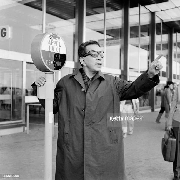Mexican actor Cantinflas is seen upon his arrival at Orly airport south of Paris on April 1 1961