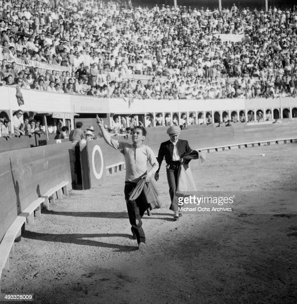 Mexican actor Cantinflas performs at bull fighting ring in Mexico
