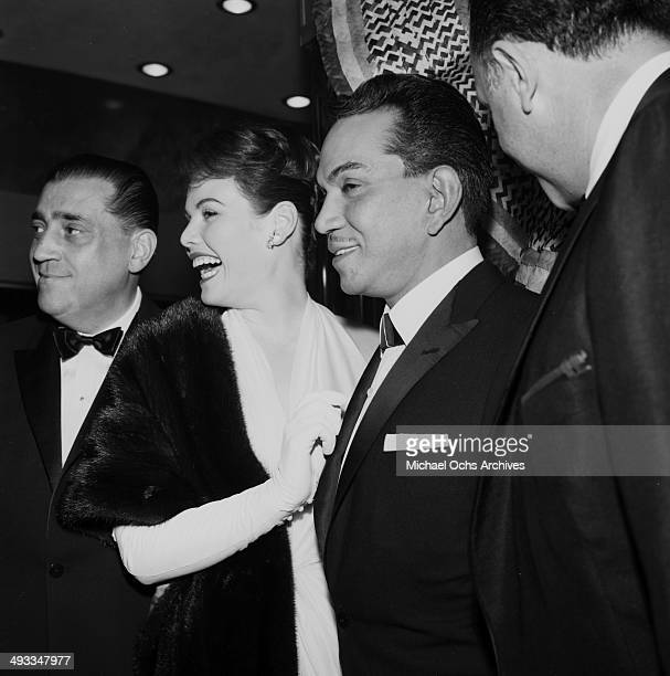 Mexican actor Cantinflas poses with Jo Morrow in Los Angeles California