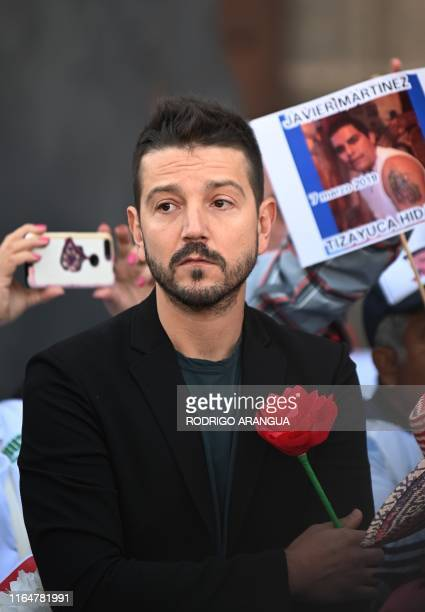 Mexican actor Diego Luna take part in a demonstration in front of the National Palace during the commemoration of the International Day of the...