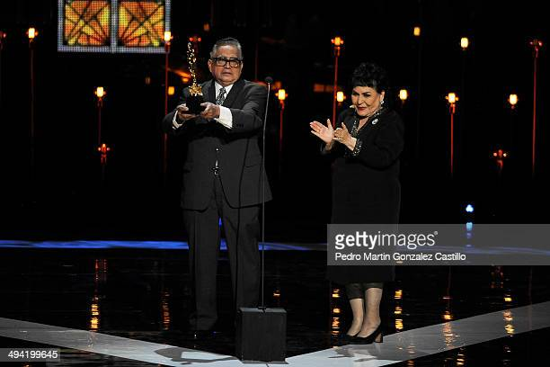 Mexican actor Ernesto Gomez Cruz receives an Ariel during the 56th Ariel Awards Ceremony at Palace of Fine Arts on May 27 2014 in Mexico City Mexico
