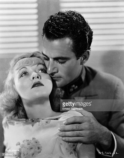 Mexican actor Gilbert Roland plays the part of Austrian officer Captain Rudolph 'Rudy' Ritter whispering sweet nothings to Constance Bennett as Carla...