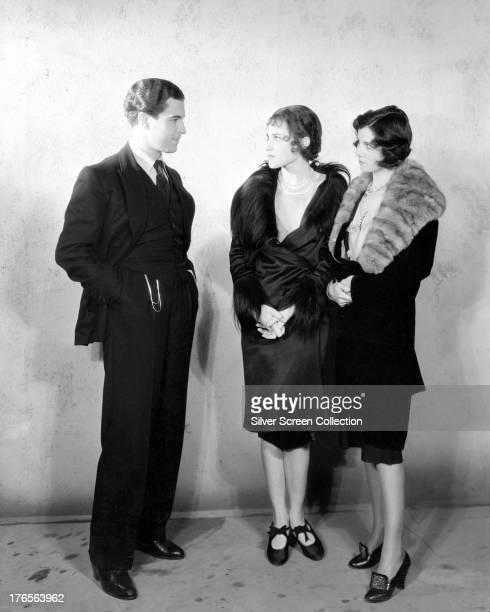 Mexican actor Ramon Novarro with two young women, circa 1925.