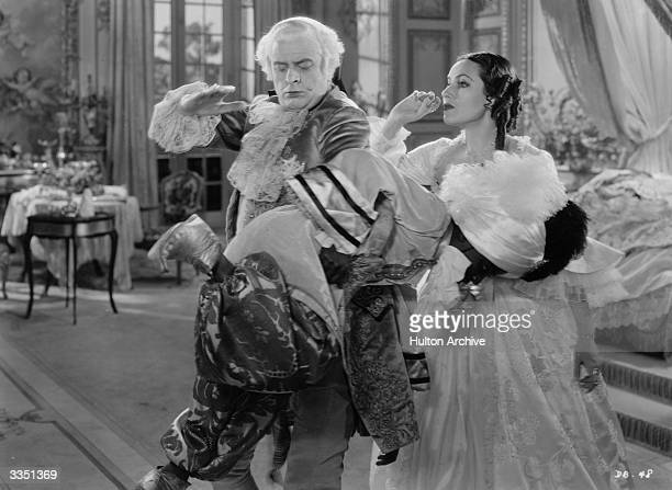 Mexican actress Dolores del R o as Madame DuBarry watching Reginald Owen spank a wayward black domestic in William Dieterle's remake of 'Madame...