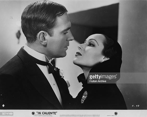Mexican actress Dolores Del Rio with character actor Pat O'Brien in a scene from the film 'In Caliente', directed by Lloyd Bacon for Warner Brothers.