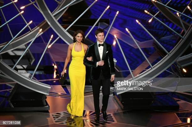 Mexican actress Eiza Gonzalez and US actor Ansel Elgort arrive on stage to present the Oscar for Best Sound Editing during the 90th Annual Academy...
