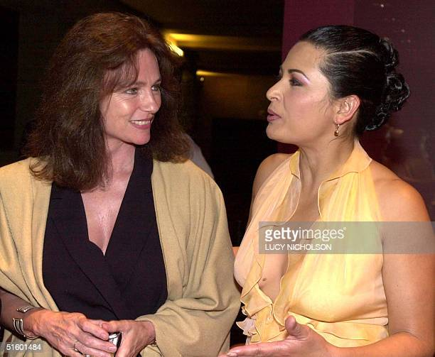 Mexican actress Elpidia Carrillo talks to British actress Jacqueline Bisset at the postpremiere party of her new film Bread and Roses at the Egyptian...