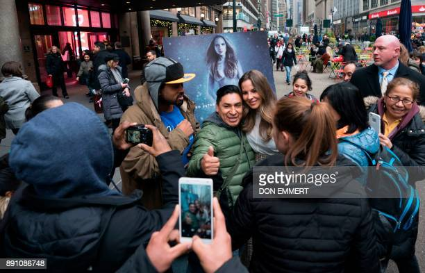 Mexican actress Kate del Castillo poses for pictures at the unveiling of her new holiday shopping campaign for PETA that proclaims 'I'd Rather Go...