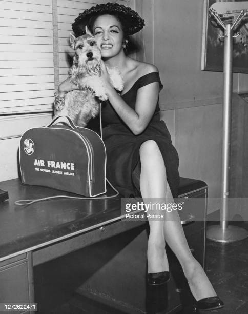 Mexican actress Katy Jurado holds her dog upon her arrival at John F Kennedy International Airport, New York, US, 1956.
