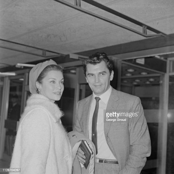 Mexican actress Linda Christian and British actor Edmund Purdom at Heathrow Airport London UK 27th September 1963