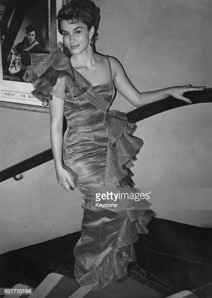 Mexican actress Linda Christian arrives at the St James's Theatre in London for the opening night of Laurence Olivier's production of the play...