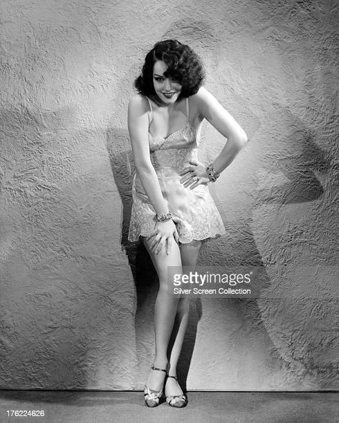 Mexican actress Lupe Velez posing in a lace camisole circa 1930
