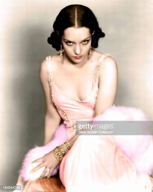 Mexican actress Lupe Velez wearing an evening dress and gold jewellery circa 1930
