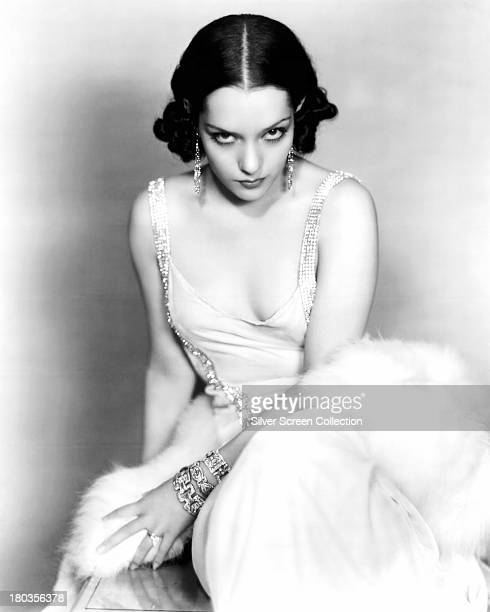 Mexican actress Lupe Velez wearing an evening dress and gold jewellery circa 1930 Photo by Silver Screen Collection/Getty Images