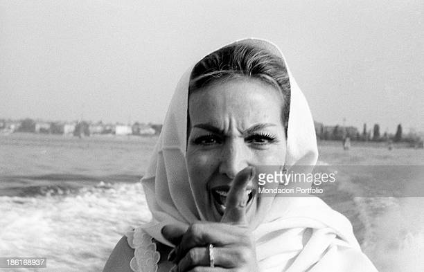 Mexican actress Maria Félix gesticulating on a boat with a scarf around her head She's taking part in the Venice Film Festival Venice August 1959