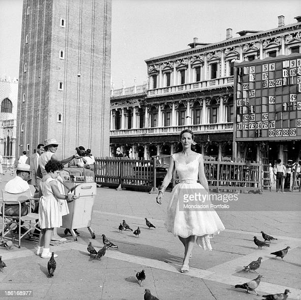 Mexican actress Maria Félix in a white dress crossing Piazza San Marco She's taking part in the Venice Film Festival Venice August 1959