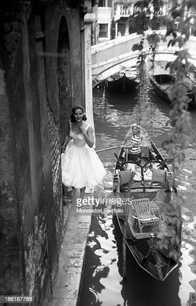 Mexican actress Maria Félix smiling beside a gondola She's taking part in the Venice Film Festival Venice August 1959