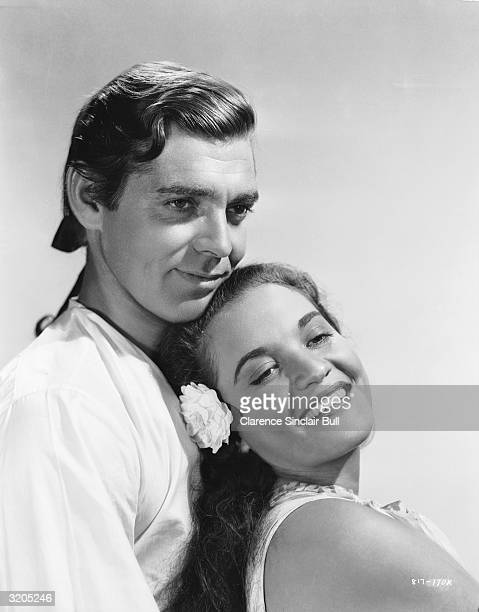 Mexican actress Movita plays the exotic islander Tehanni to Clark Gable's Fletcher Christian in 'Mutiny on the Bounty' directed by Frank Lloyd