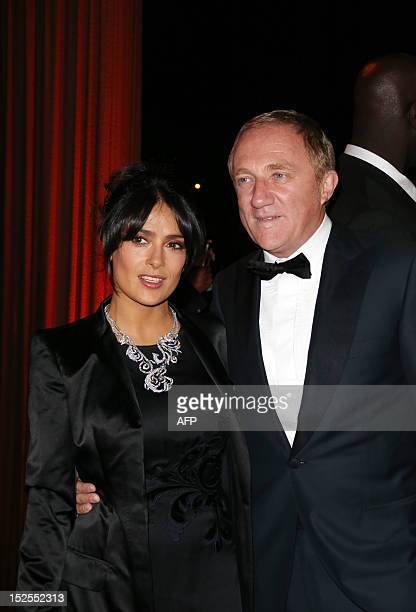 Mexican actress Salma Hayek and her husband FrancoisHenri Pinault are pictured during the inauguration ceremony of the Cite du cinema a film studios...