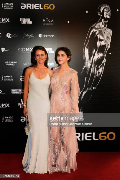 Mexican actresses Nailea Norvid and Tessa Ia pose during the Red Carpet of 60th Ariel Awards at Palacio de Bellas Artes on June 5 2018 in Mexico City...