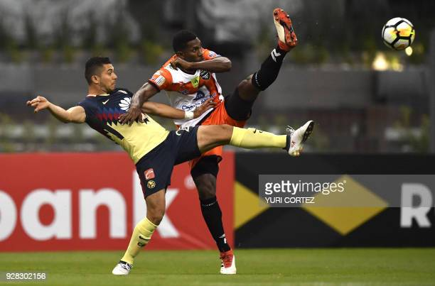Mexican America's forward Henry Martin vies for the ball with Panamanian Tauro's defender Richard Dixon during their CONCACAF Champions League first...
