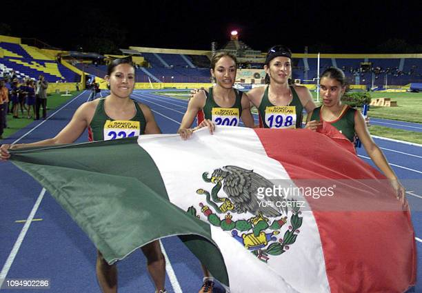 Mexican Ana Guevara celebrates with teammates 06 December 2002 after winning the 4 x 400 mt race of the XIX Central American and Carribean Games 2002...