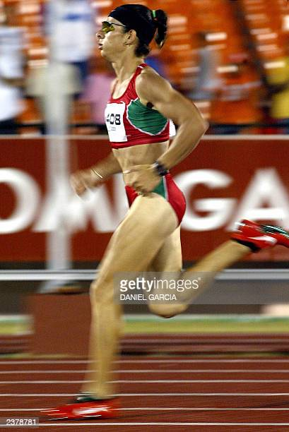 Mexican Ana Guevara runs to win the 400m semifinal 07 August 2003 at the Olympic Stadium during the XIV Pan American Games in Santo Domingo AFP...