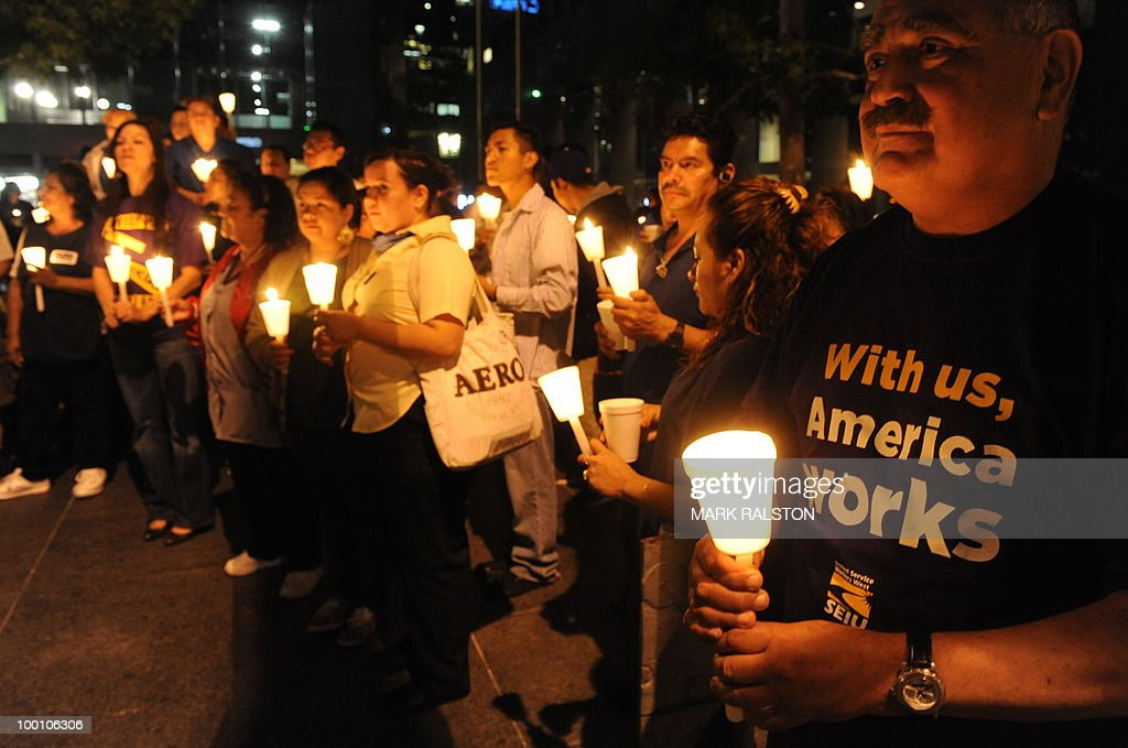 Mexican and Latino janitors hold a candl