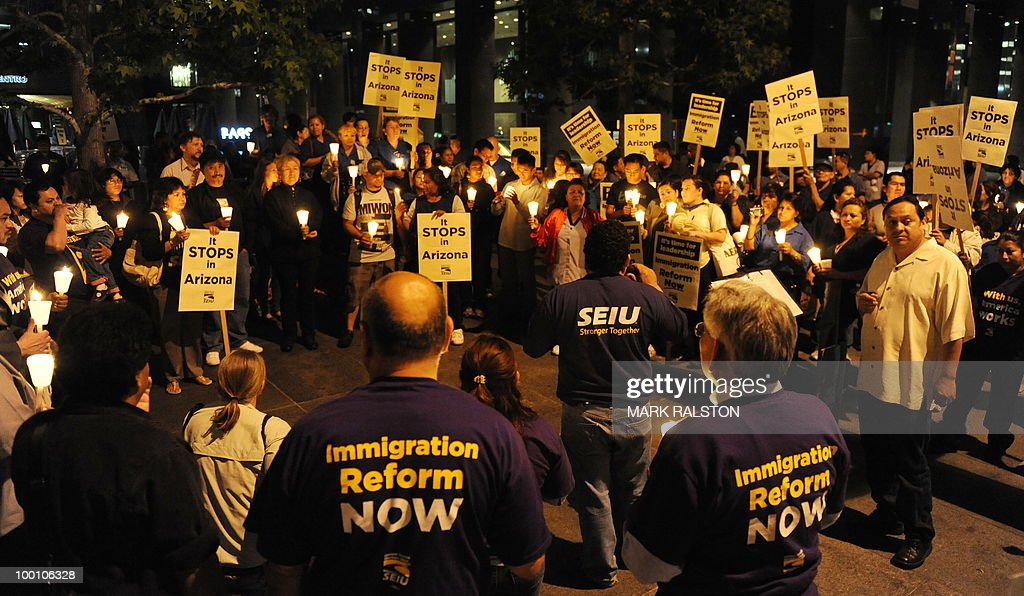 Mexican and Latino janitors hold a candlelight vigil calling for federal immigration reform, in response to the tough new Arizona law giving the police new stop and search powers, outside their place of work in Los Angeles on May 20, 2010. Mexican President Felipe Calderon urged the US government to repair an outmoded immigration system and do more to ensure that illegal guns do not flow across the countries' shared border. The Mexican leader renewed his call for an overhaul of US immigration laws that would offer up to 12 million illegal immigrants in the United States, many of them Mexicans, a path to US citizenship as well as strongly criticizing a new Arizona law that has enraged Hispanics and stoked fears of racial profiling. AFP PHOTO/Mark RALSTON