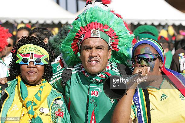 Mexican and South African football fans sing together outside Soccer City Stadium before the opening match of the 2010 World Cup in Soweto near...