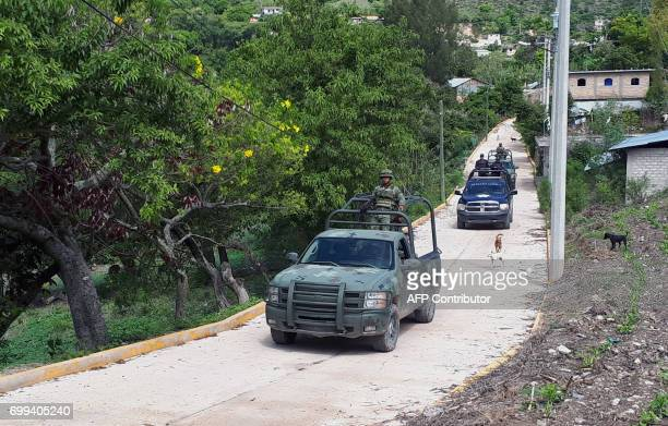 Mexican army members patrol the Ahuhuiyuco community in Chilapa de Alvarez Guerrero state Mexico on June 20 2017 Some 800 families have fled their...