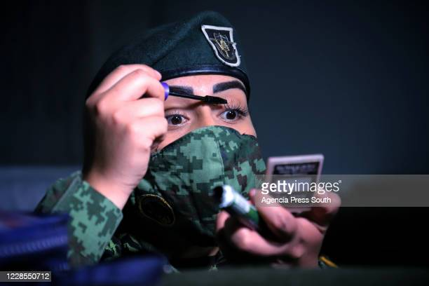 Mexican army officer uses mascara for her eyelashes prior the Independence Day military parade at Zocalo Square on September 16, 2020 in Mexico City,...