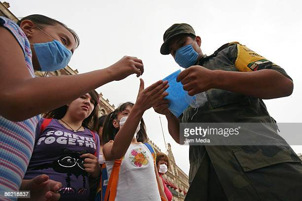 Mexican Army personnel distribute face masks as prevention against the swine flu virus on April 25 2009 in Mexico City Mexico An outbreak of deadly...