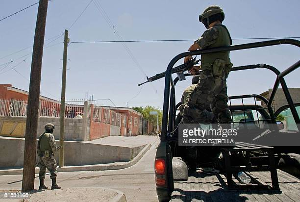 Mexican Army soldiers patrol the empty streets of the Mariscal neighborhood following a wave of violence sowed by the drug cartels' struggle for...