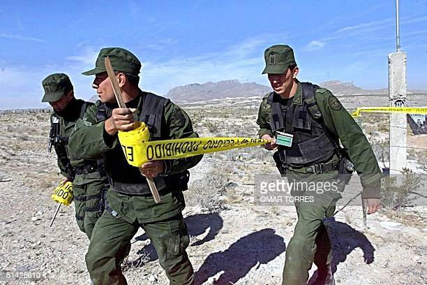 Mexican army troops cordonoff the Tiro del Norte Ranch near Juarez City at the border with the US 30 November where some 600 Mexican and FBI agents...