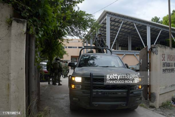A Mexican Army's vehicle exits the regional prosecutor's office in Tepochica Iguala municipality Guerrero state Mexico on October 16 2019 14...