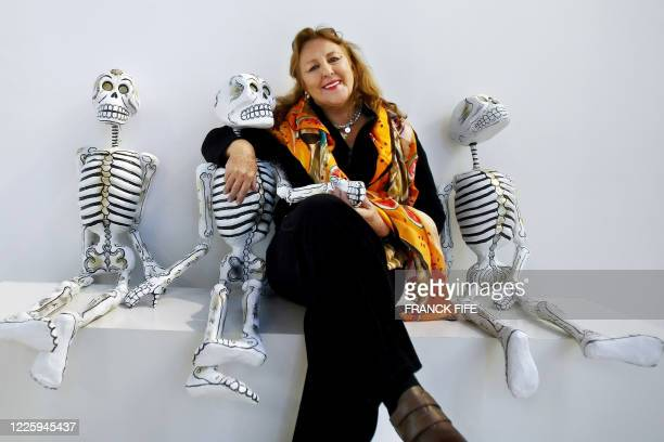 Mexican artist Christina Rubalcava poses with carton skeletons 24 October 2007 at the Branly museum in Paris The museum pays an homage to Mexico and...