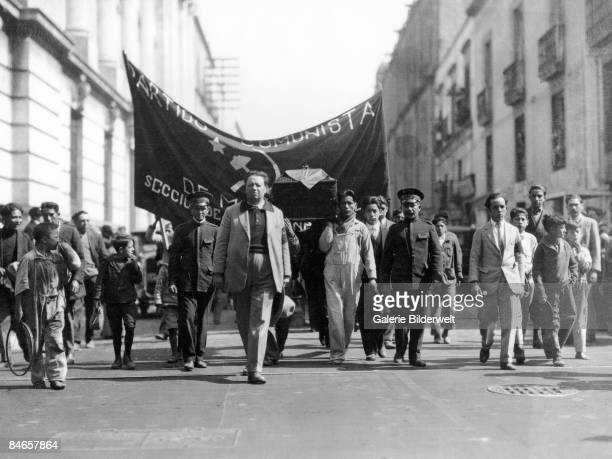 Mexican artist Diego Rivera leads the funeral procession of assassinated Cuban revolutionary Julio Antonio Mella through Mexico City January 1929
