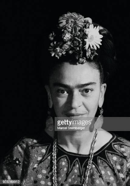 Mexican artist Frida Kahlo wearing flowers in her hair Mexico City 1952