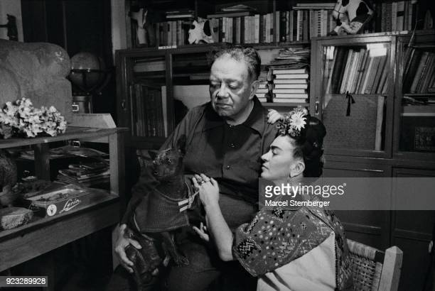 Mexican artists Frida Kahlo and Diego Rivera with a dog Mexico City 1952